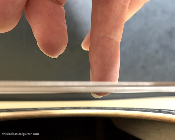 Nail Contact on String for Classical Guitar - a finger